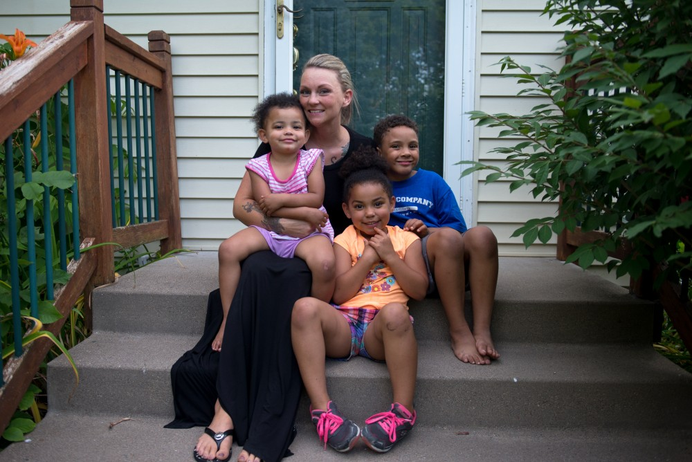 Brittany Seaver poses for portraits with her children Serenidee, Jazzlynn and William Watson outside their home in Plymouth, Minnesota on Monday. Brittany is now involved with the Minnesota Prison Doula Project, giving support and advice to pregnant inmates and new moms who are incarcerated.