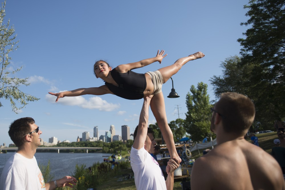 Hannah Maccarone practices her poses before performing in the River Rats Aquatennial Show on the Mississippi in Minneapolis on Fri. July, 2017.