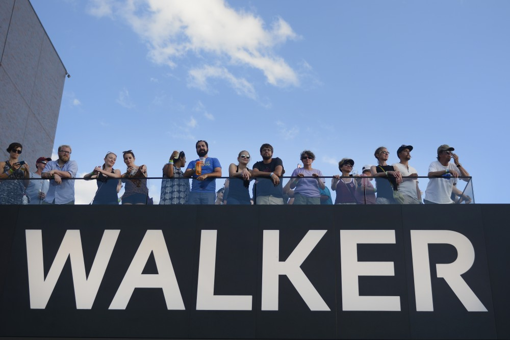 Attendees of Rock the Garden look out over the event at the Walker Art Center on July 22, 2017.