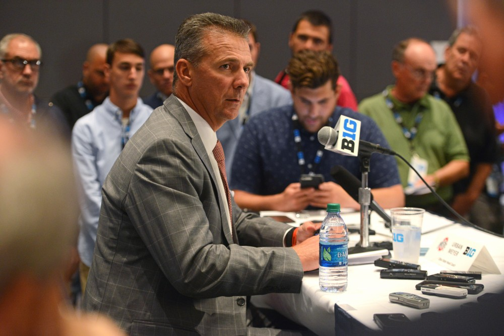 The Ohio State University head coach Urban Meyer fields media questions during the Big Ten Media Days event Monday at the at McCormick Place Convention Center in Chicago.