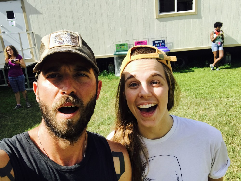 Mondo Cozmo front man Josh Ostrander and reporter Katie Lauer pose for a selfie at Bonnaroo.