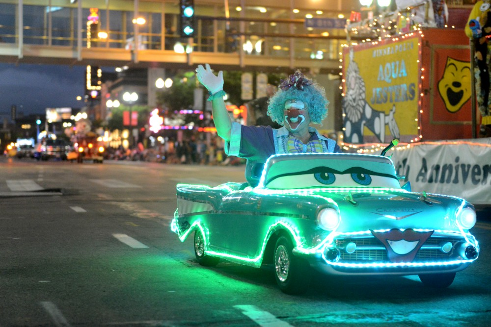 An Aqua Jester rides around in the 17th annual CenterPoint Energy Torchlight Parade along Hennepin Avenue on Wednesday.