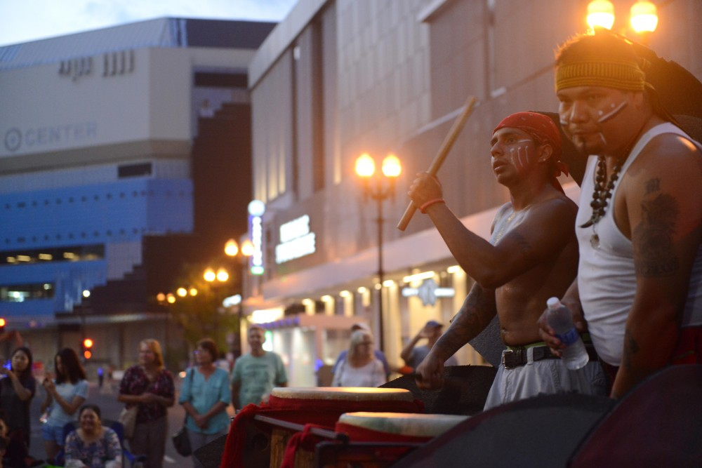 Kalpulli Ketzal Coatlicue drummers play in the 17th annual CenterPoint Energy Torchlight Parade along Hennepin Avenue on Wednesday.