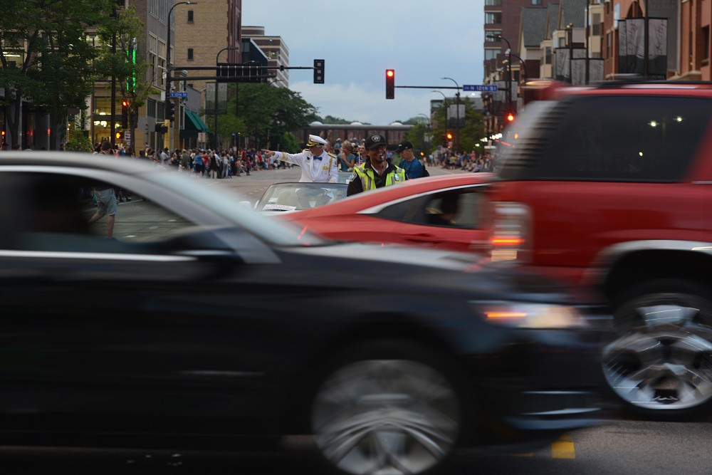 Traffic crosses the 17th annual CenterPoint Energy Torchlight Parade along Hennepin Avenue on Wednesday.