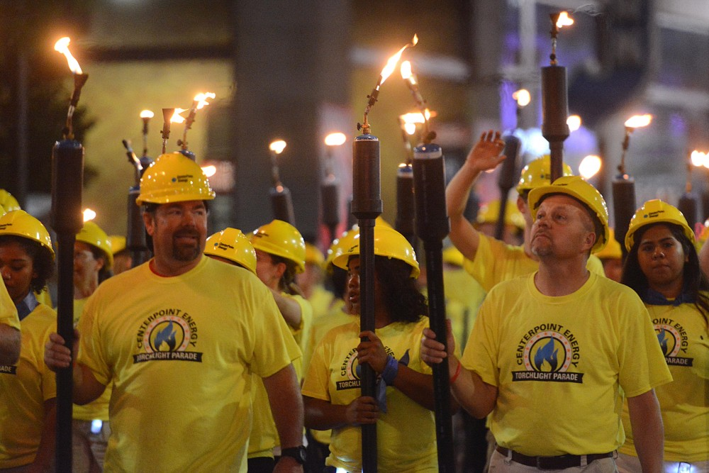 Centerpoint Energy participates in the 17th annual CenterPoint Energy Torchlight Parade along Hennepin Avenue on Wednesday.