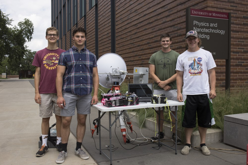 From left, University engineering students Simon Peterson, Garrett Ailts, Michael Waataja and Austin Eilers pose for a portrait with weather balloon technology they created to live stream the solar eclipse later this month on Tuesday, August 1, 2017 at at the Physics and Nanotechnology Building on East Bank in Minneapolis, Minnesota.