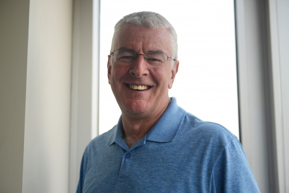 Dr. B.R. Simon Rosser, the director of HIPS, poses for a portrait at the Program in Human Sexuality building on the west bank. Rosser's research focuses on preventing colon cancer in gay, bisexual, and other men who sleep with men, which follows a national shift in focusing on preventative care rather than treatment based, retroactive care.