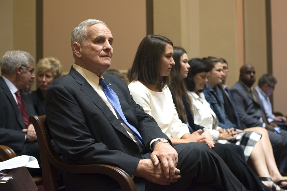 Gov. Mark Dayton waits for oral arguments to begin before the Minnesota Supreme Court on Monday, Aug. 28, 2017, at the Capitol in St. Paul.