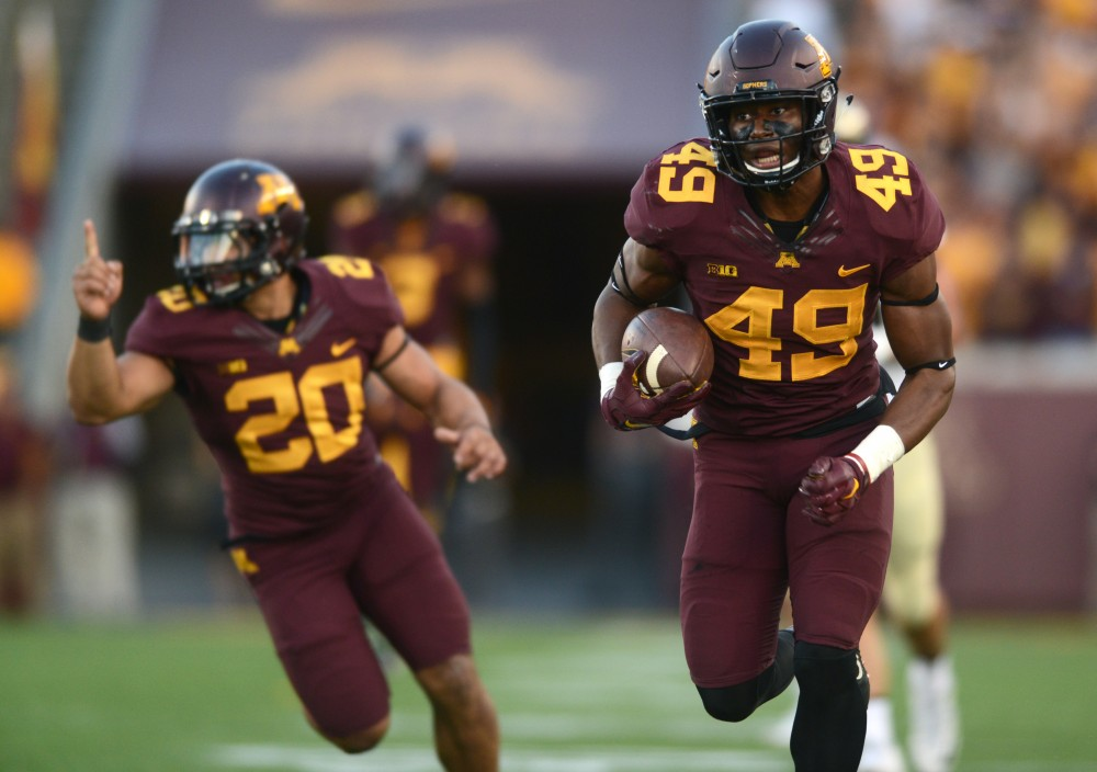 Gophers linebacker Kamal Martin runs into the end zone for the Gophers during their game against Purdue at TCF Bank Stadium on Nov. 5, 2016.
