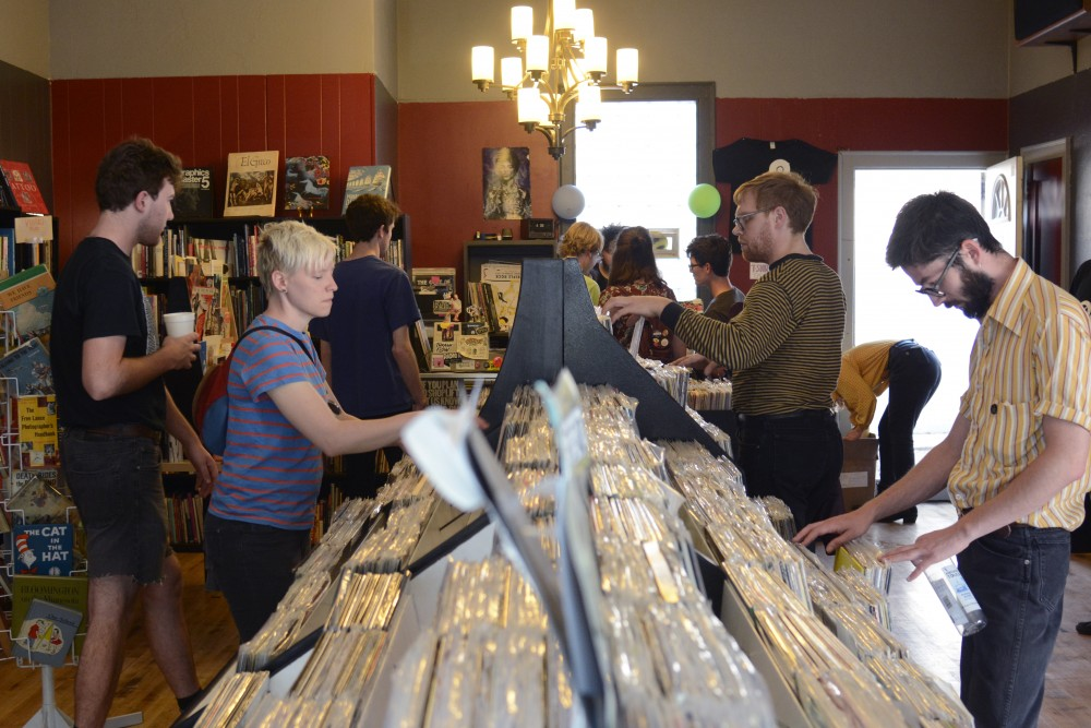 Patrons browse through records on Saturday Sept. 2, at Dead Media's grand re-opening in South Minneapolis. Dead Media is a record, tape and book store that now has a performance space in the basement.