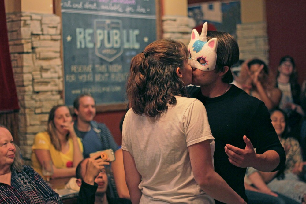 Actors Olivia Wilusz, left, and Dan Piering kiss while preforming the masquerade scene from Romeo and Juliet with BARd Shakes at Republic on West Bank on Sept. 4. BARd Shakes is a Minneapolis a theatre troupe that specializes in performing Shakespeare plays at local bars.