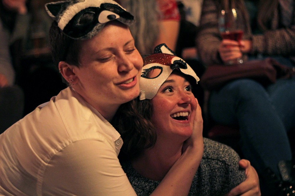 Actors Ashely Montondo, left, and Caroline Amos perform a scene from Romeo and Juliet with BARd Shakes as Benvolio and Mercutio at Republic on West Bank on Sept. 4. BARd Shakes is a Minneapolis a theatre troupe that specializes in performing Shakespeare plays at local bars.