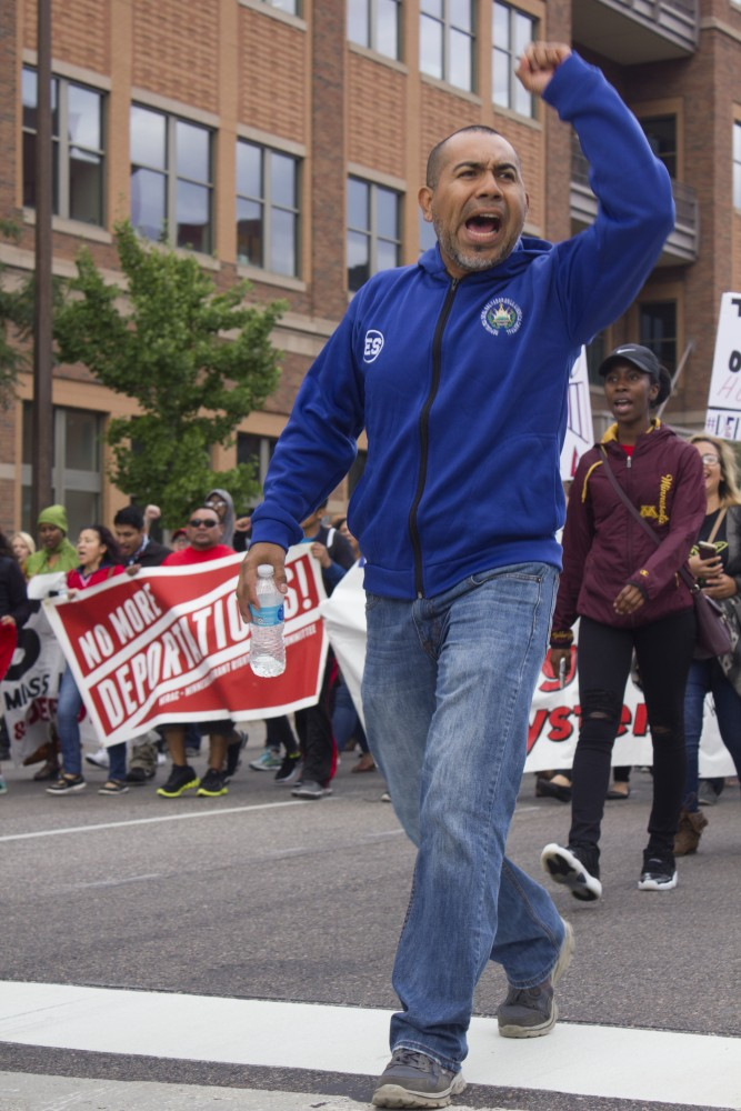 William Martenec of MIRAC, leads the march along Washington Ave on Sept. 9.
