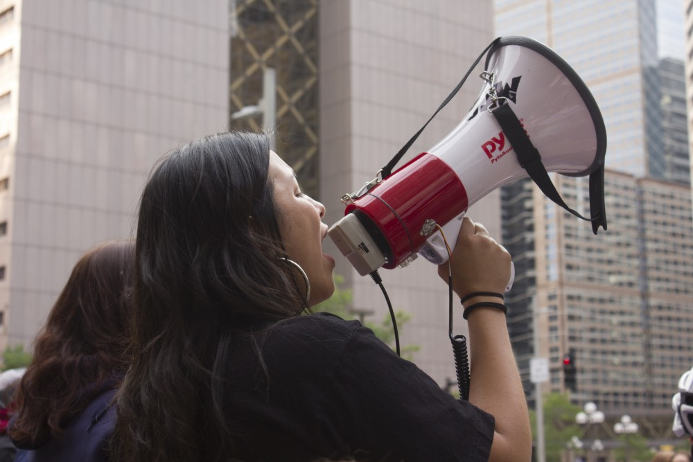 ISIAH organizer and DREAMer Catalina Morales de Sanchez speaks to a crowd of protesters outside the Hennepin County Public Safety Facility on Sept. 5 in downtown Minneapolis.