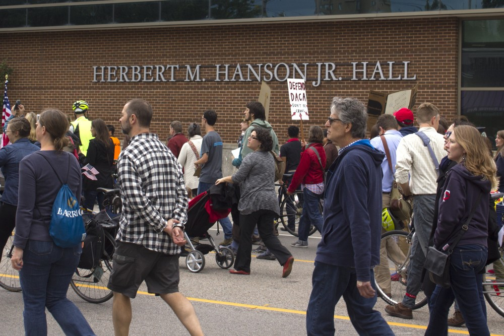 Demonstrators march past Herbert M. Hanson Jr. Hall to protest the repeal of the Deferred Action for Childhood Arrivals policy on Sept. 5.