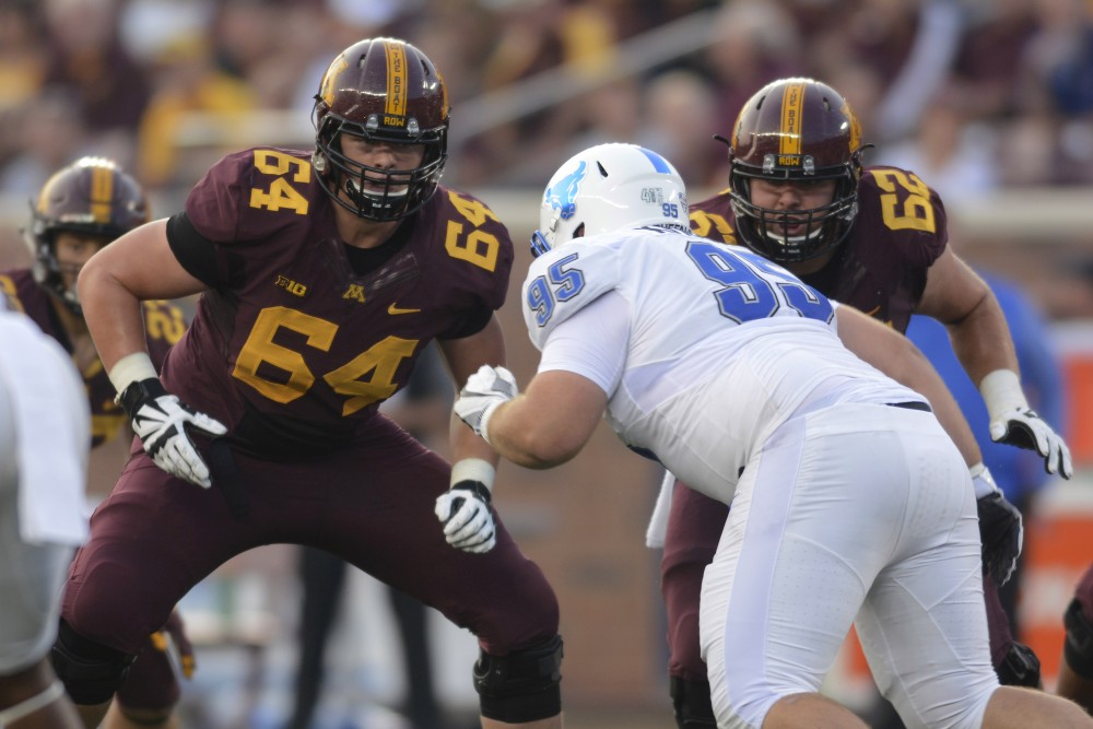 Offensive lineman Conner Olson prepares to block on Thursday, Aug. 31, 2017 at TCF Bank Stadium.