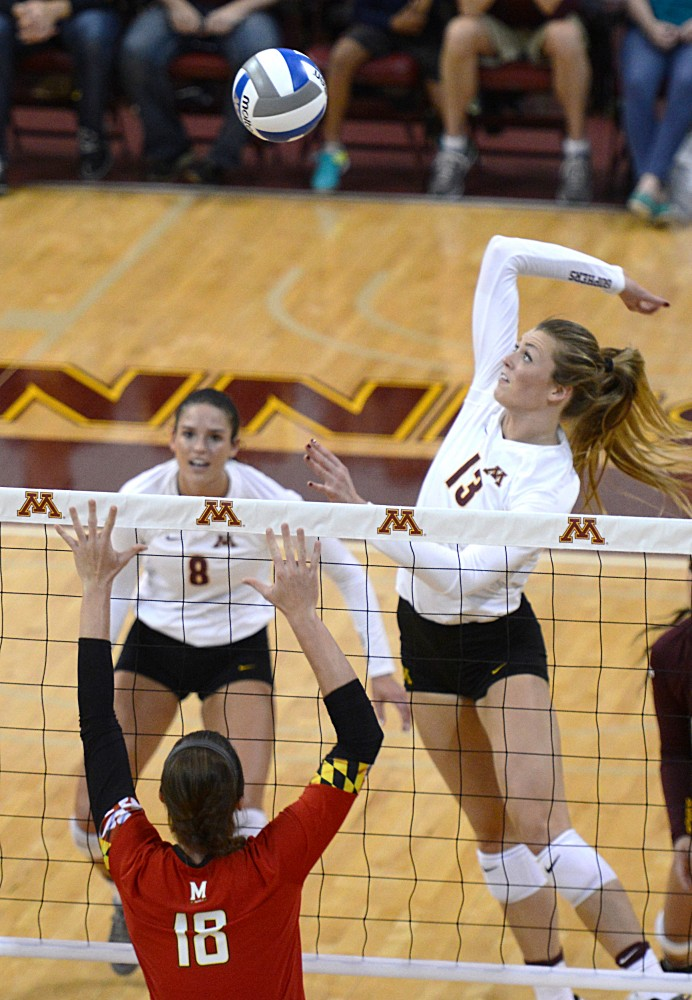 Gophers Middle Blocker Molly Lohman gets ready to strike the ball back to Maryland on Friday, Sept. 23, 2016 in the Sports Pavillon.