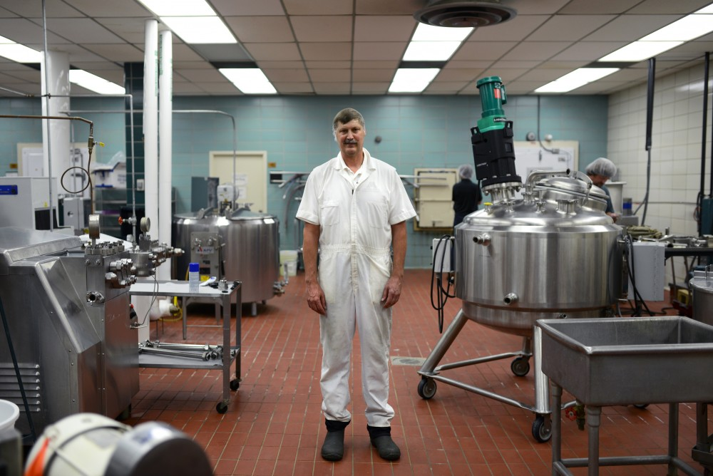 Pilot plant coordinator Ray Miller stands in front machinery used to make ice cream sold on the St.Paul campus on Wednesday, Sept. 6.