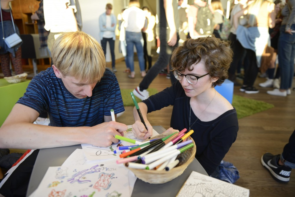 Abby Capistrant and Steven Bulfer, sophomores at the U, spend time coloring at WAM-O-Rama at the Weisman Art Museum on Sept. 8, 2017.