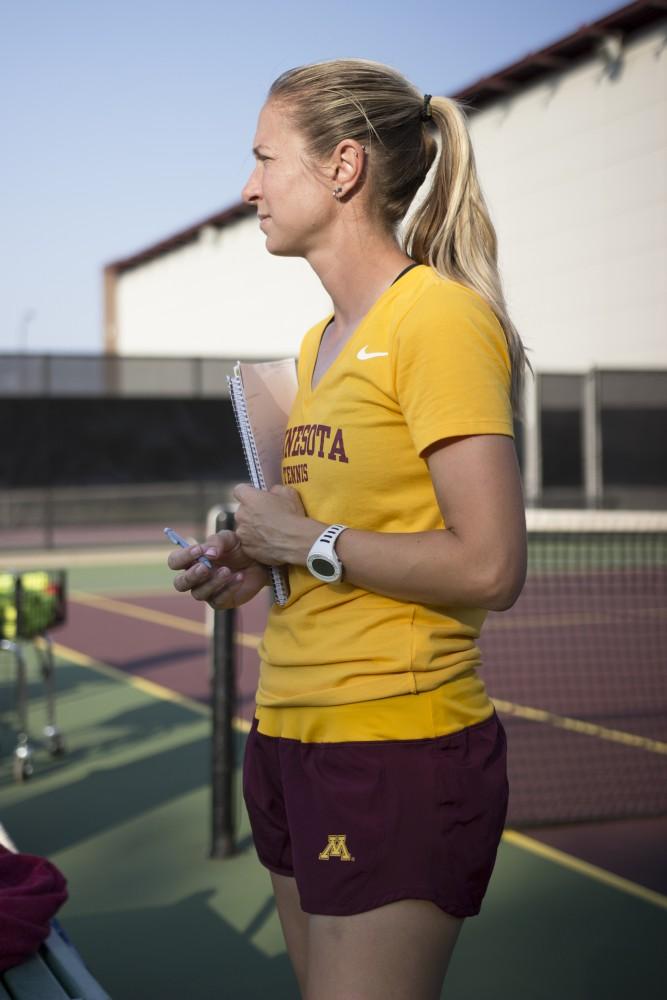 Head women's tennis coach Catrina Thompson observes practice on Tuesday, Sept. 12.