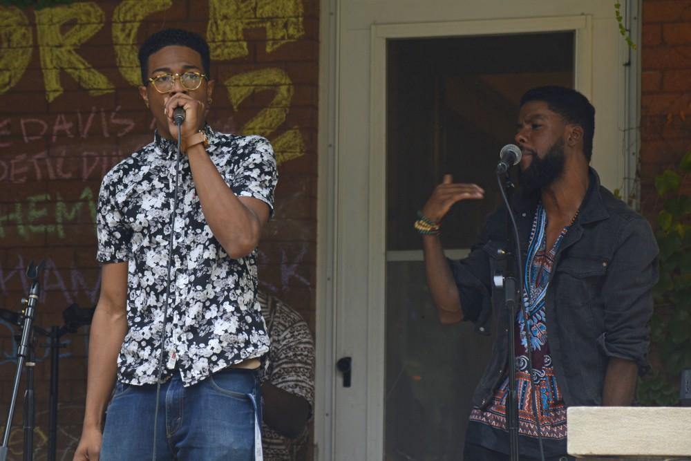 Joe Davis and the Poetic Diaspora freestyle a verse at the Powderhorn PorchFest on Saturday, Sept. 23.