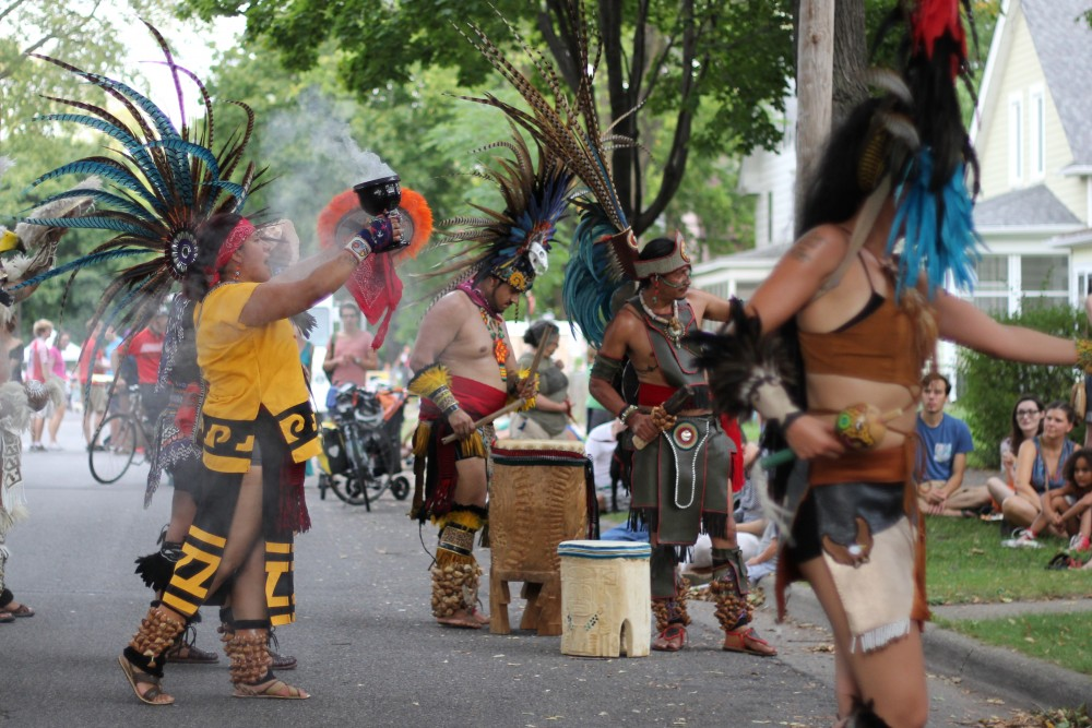The Kalpulli KetzalCoatlicue Danzantes perform a traditional dance at the Powderhorn PorchFest on Saturday, Sept. 23.