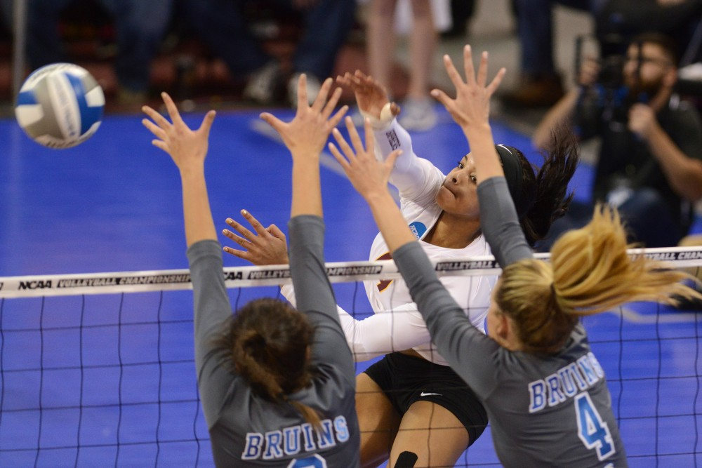 Outside hitter Alexis Hart pushes the ball past UCLA in the Sports Pavilion on Dec. 10, 2016.
