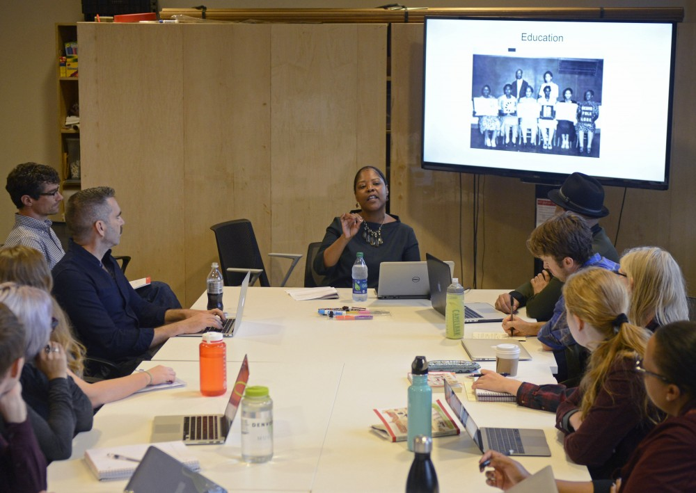 Melanie A. Adams from the Minnesota Historical Society talks with students who are part of a new interdisciplinary graduate program at Northrop Auditorium on East Bank on Monday, Sept. 25.