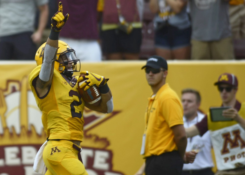Junior defensive back Jacob Huff runs in for a touchdown against Middle Tennessee on Sept. 16 at TCF Bank Stadium.