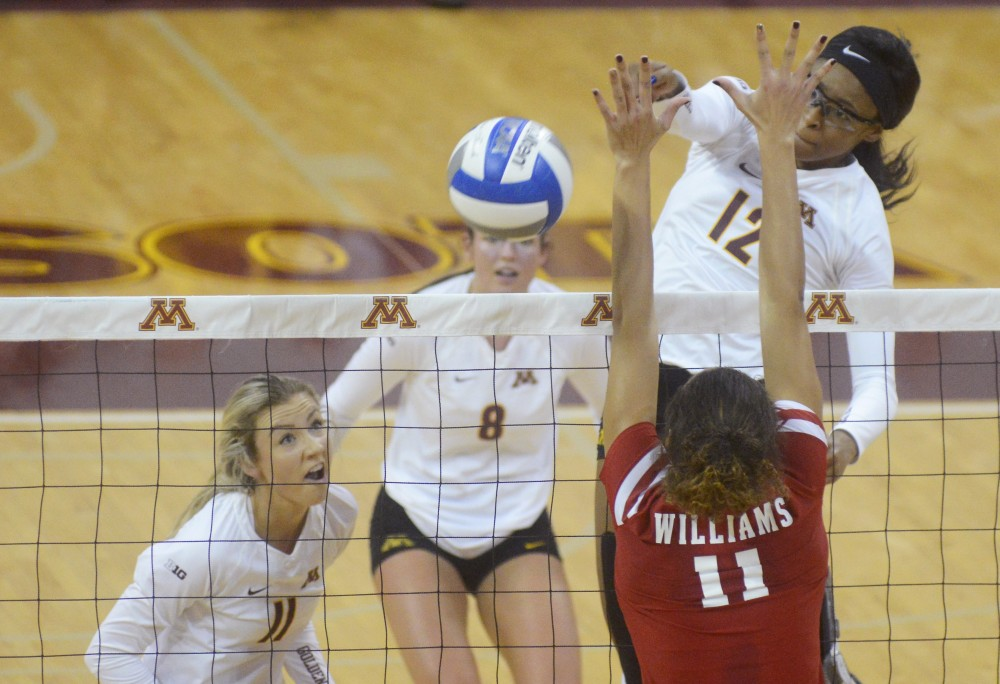 Redshirt sophomore middle blocker Taylor Morgan blocks the ball from Wisconsin at Maturi Pavilion on Nov. 26, 2016.