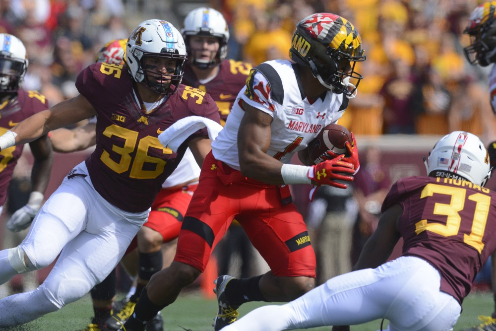 Two Gophers players go in for the tackle on Saturday, Sept. 30 at TCF Bank Stadium.