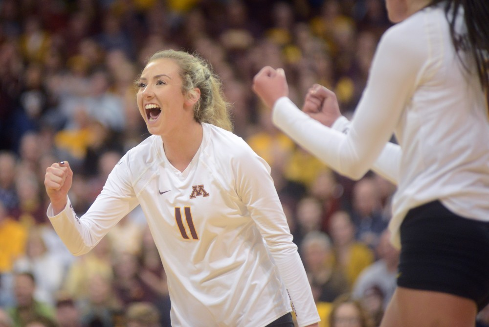 Setter Samantha Seliger-Swenson cheers after the Gophers score a point on Friday, December 2, 2016 at the Sports Pavilion.