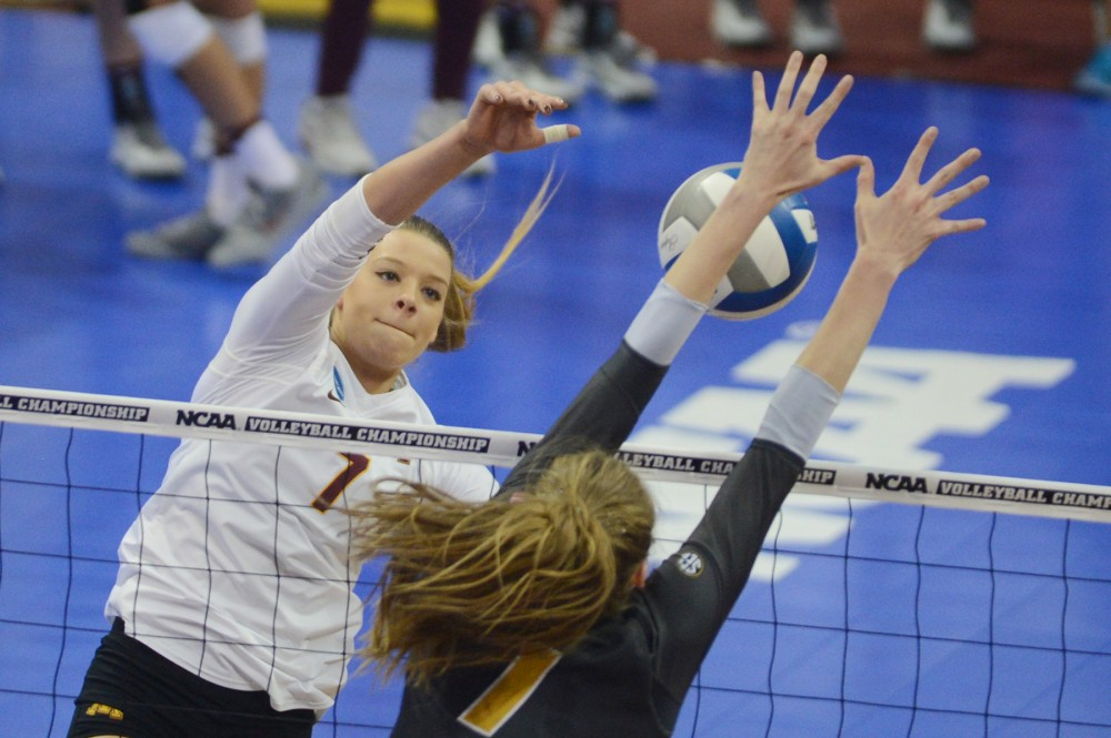 Gophers middle blocker Hannah Tapp attempts to return the ball on  Friday, Dec. 9, 2016 at the Sports Pavilion during the NCAA regional semifinal game against Missouri.