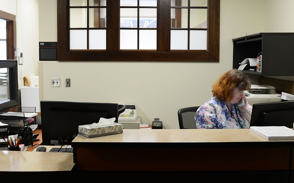 Nurse Jody Geinger speaks on the phone at the new Boynton Health Services mental health clinic. The clinic, located on the St. Paul campus, offers services in mental health, nutrition, physical therapy and primary care.