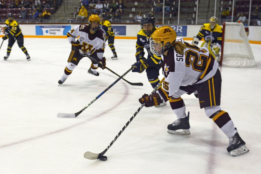 Redshirt junior forward Nicole Schammel readies a pass during a game against Merrimack at Rider Arena on Friday.