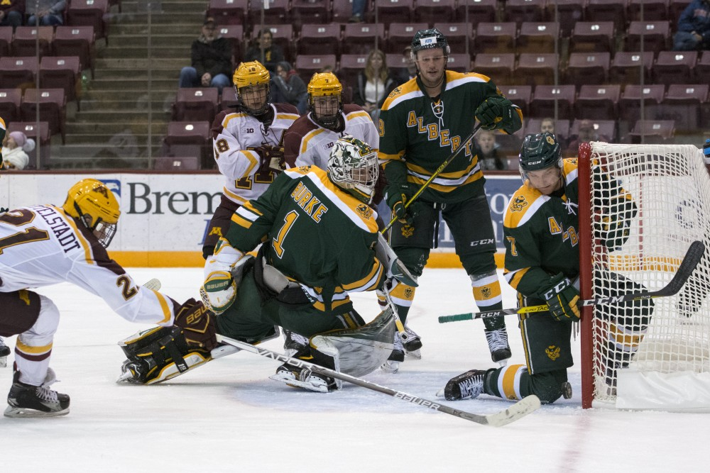 Freshman forward Casey Mittelstadt reaches to score the first goal of his career as a Gopher for a 6-2 exhibition win over Alberta on Sunday, Oct. 1 at 3M Arena at Mariucci.