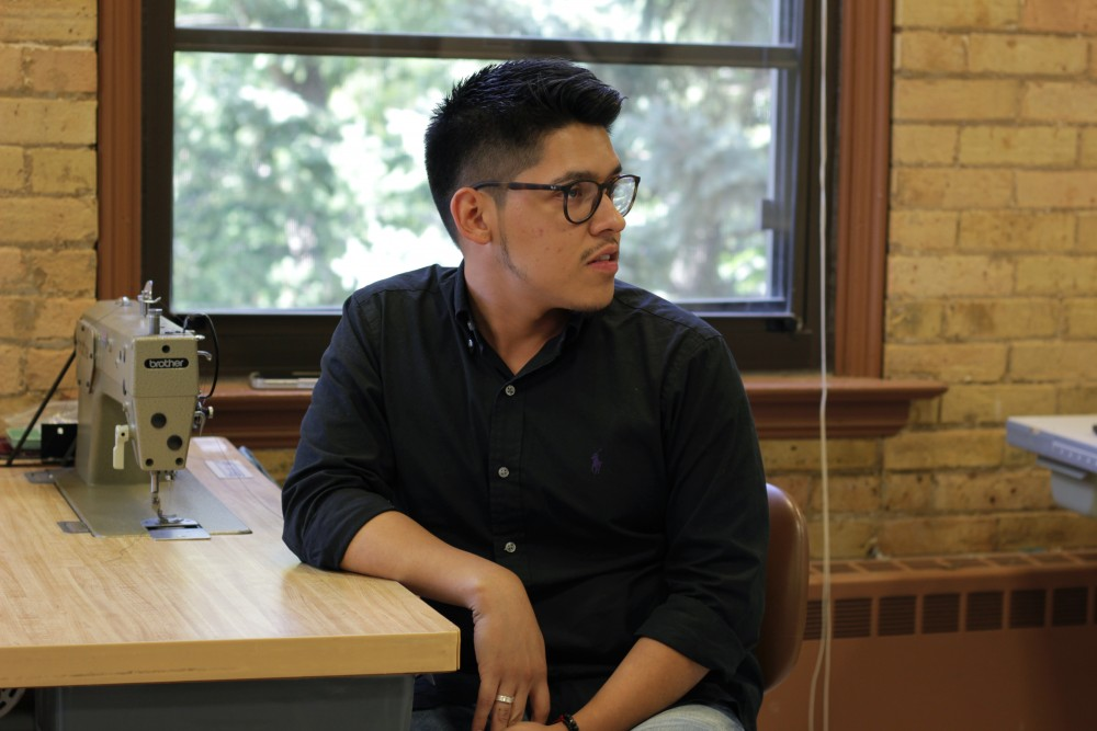 Fashion designer and apparel design major Ivan Gil speaks with the Minnesota Daily about his experiences in design in McNeal Hall on Friday, Sept. 29.