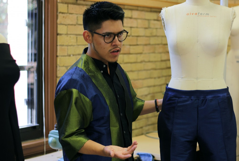 Accomplished fashion designer and University of Minnesota student Ivan Gil showcases one of the unisex outfits that he designed in McNeal Hall on Friday, Sept. 29th.