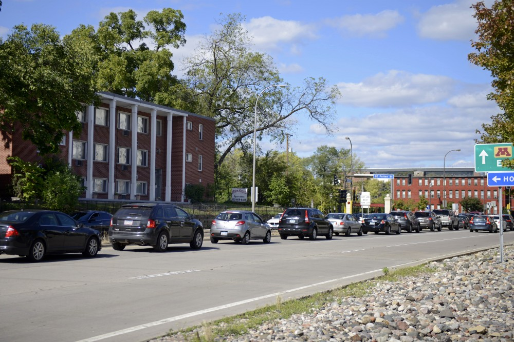 Traffic on Huron Boulevard on Friday, Sept. 29. The University of Minnesota recently purchased the property seen left, with plans to expand one of the main campus thoroughfares.