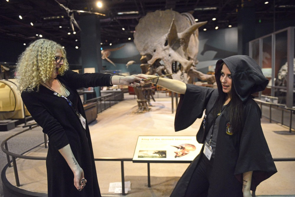 Hannah Doyle and Lindsey Bronson pose for a photo at the Wizard Camp-In on Friday, Sept. 29 at the Science Museum of Minnesota in St. Paul.