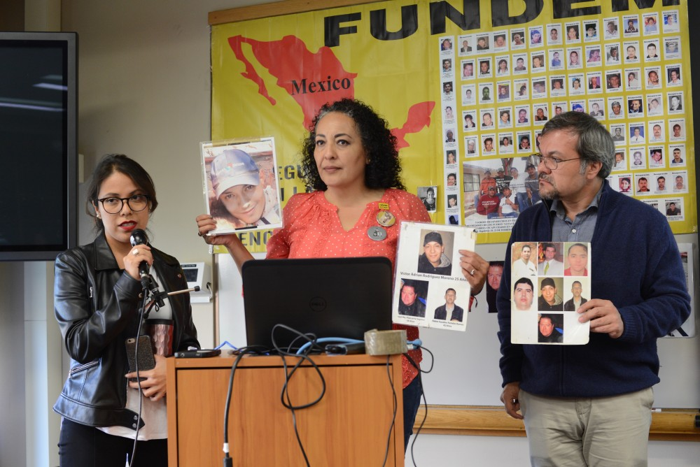 Adriana Moreno Becerril, center, speaks about her missing son through a translator at a University of Minnesota Human Rights Program press briefing on disappearances in northern Mexico at the Humphrey School of Public Affairs on Tuesday, Oct. 3.