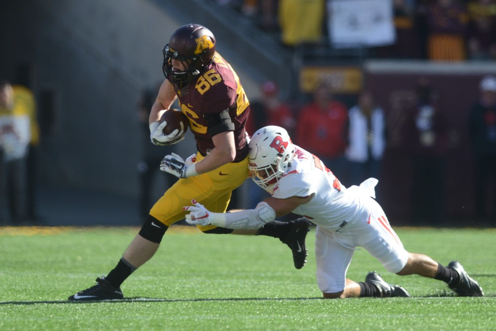 Tight end Brandon Lingen is tackled on Saturday, Oct. 22, 2016 at TCF Bank Stadium.