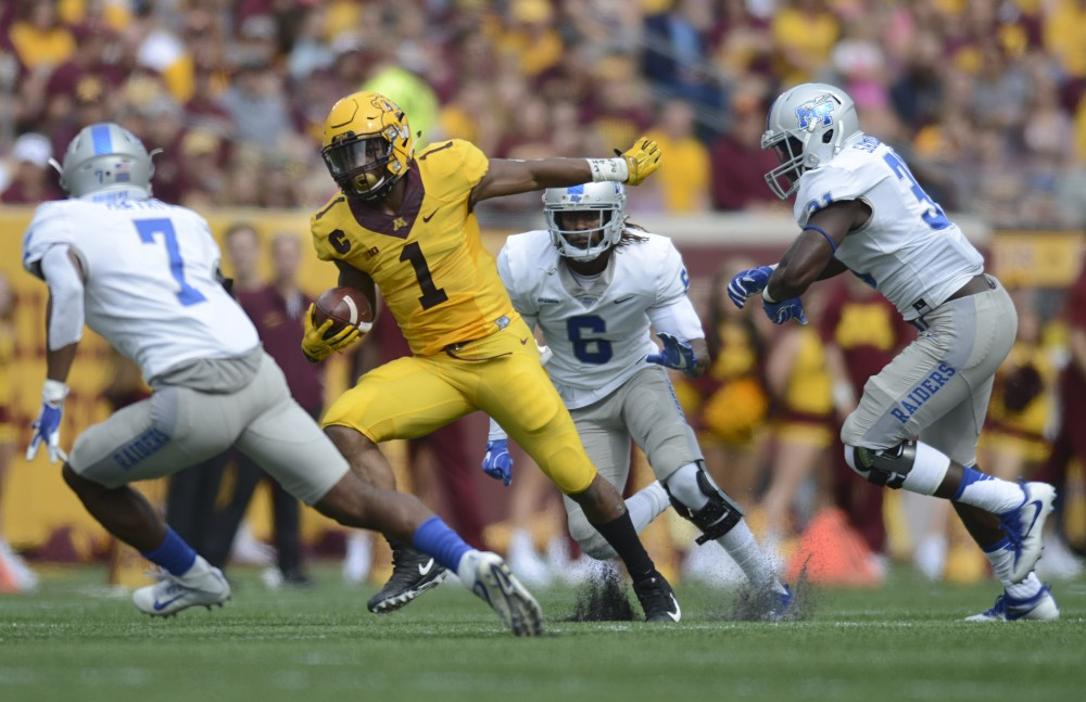 Running back Rodney Smith runs with the ball on Saturday, Sept. 16 at TCF Bank Stadium.