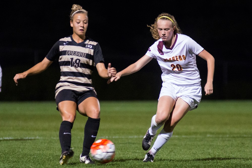 Gophers forward April Bockin fights for the ball against Purdue at Elizabeth Lyle Robbie Stadium, Sept. 25, 2015.