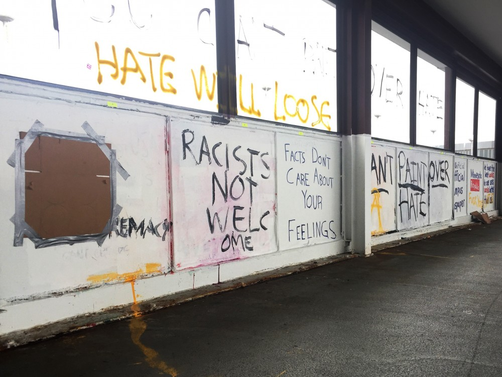 UMN student groups Turning Point USA, College Republicans and the Minnesota Republics panels on the Washington Avenue Bridge on Saturday morning. By Sunday morning, all nine panels were painted over.