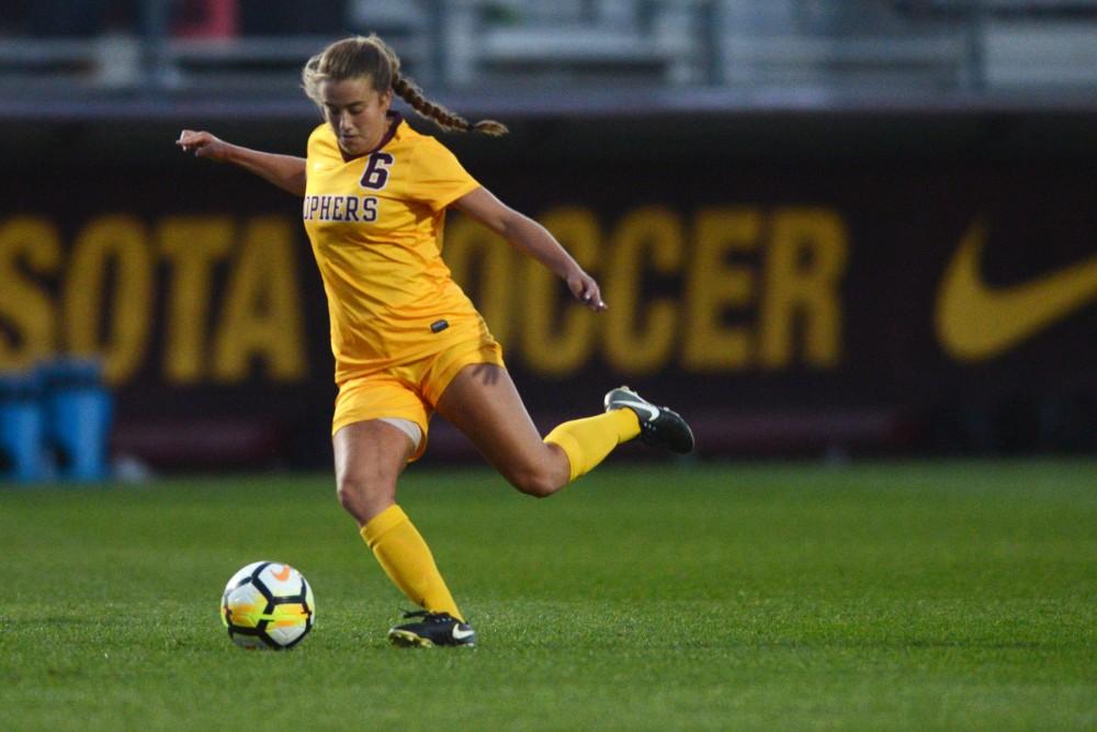 Junior midfielder Molly Fiedler kicks the ball during the Gophers' match against Utah State at Elizabeth Lyle Robbie Stadium on Sept. 8.