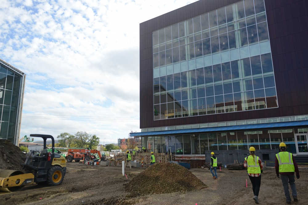 Construction taking place at the new Athletes Village complex on Thursday, Oct. 12.