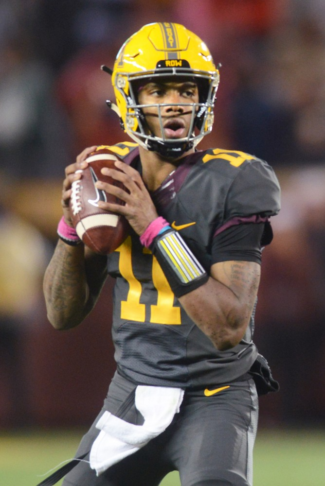 Quarterback Demry Croft prepares to pass the ball during the game against Michigan State on Saturday, Oct. 14 at TCF Bank Stadium in Minneapolis. The Spartans beat the Gophers 30-27.