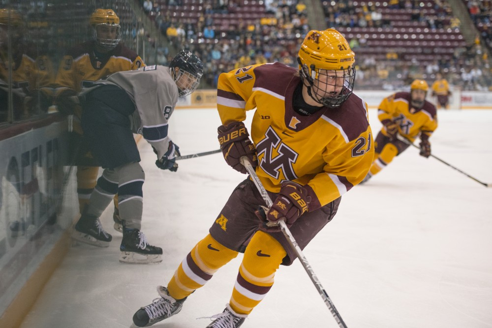 Forward Casey Mittelstadt follows the puck during the Gophers game against Penn State on Sunday at 3M Arena at Mariucci. The Gophers won 6-3.