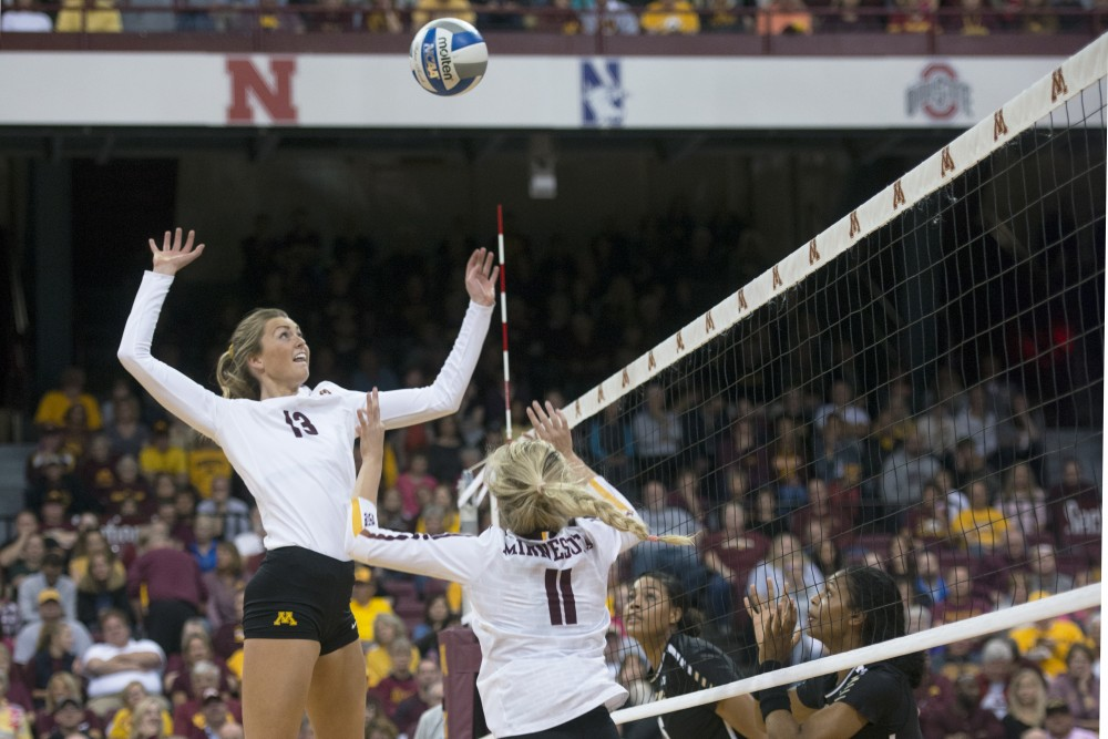 Middle blocker Molly Lohman jumps to spike the ball against Purdue on Wednesday, Oct. 11 at the Maturi Pavilion.